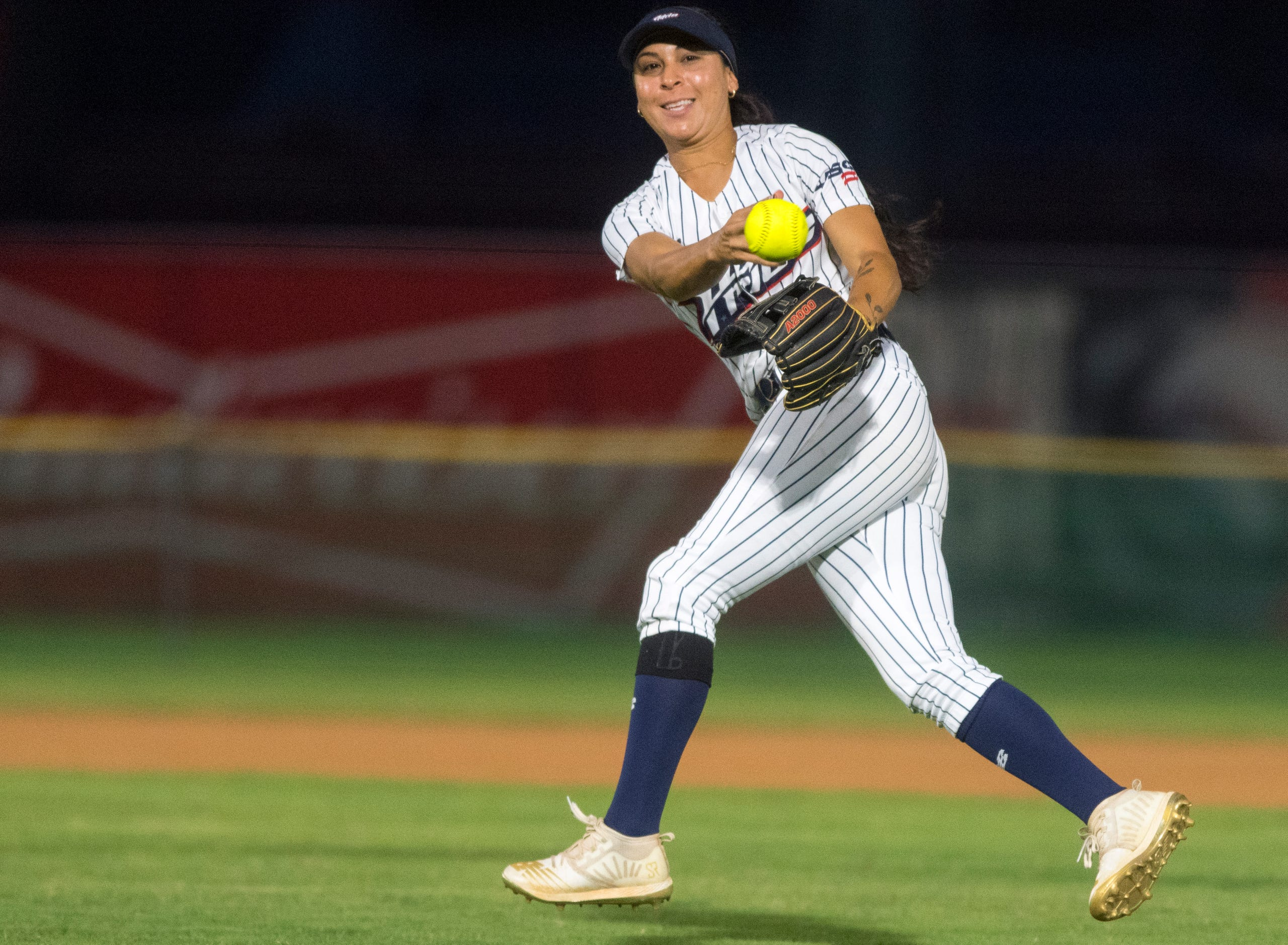 USSSA Pride's Sierra Romero (32) throws to first as the USSSA Pride takes on Team Florida in an exhibition game at Bosse Field in Evansville, Ind., Wednesday evening, July 14, 2021.