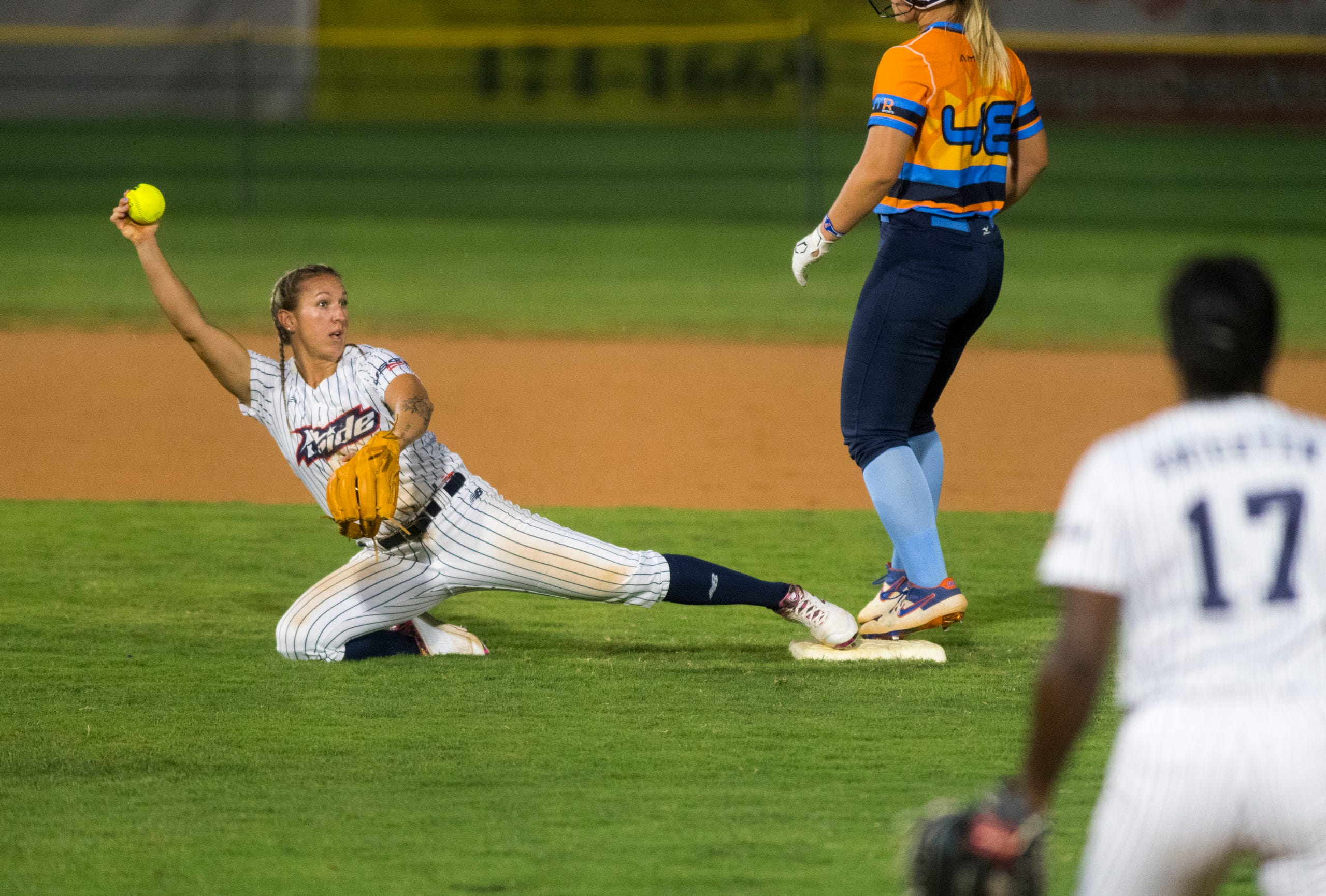USSSA Pride's Shelby Pendley (2) holds out the ball as she outs a runner at second during the USSSA Pride vs Team Florida in an exhibition game at Bosse Field in Evansville, Ind., Wednesday evening, July 14, 2021.