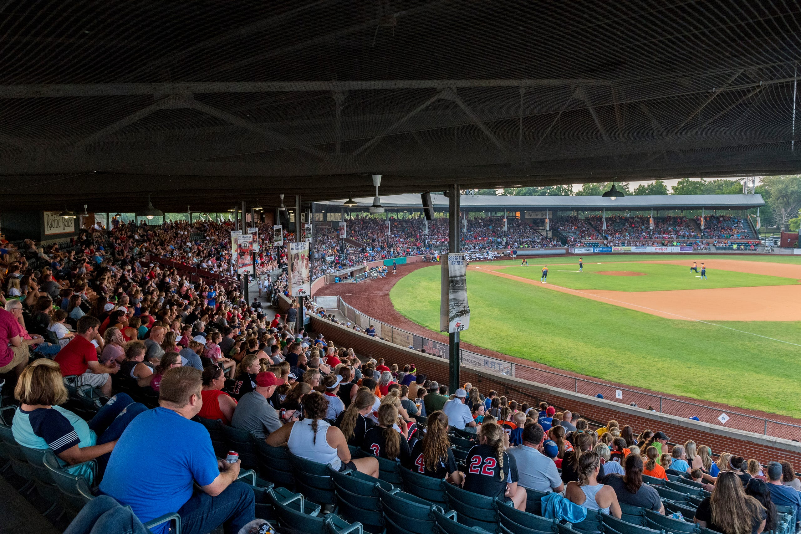 A large crowd fills the stands for the exhibition game between USSSA Pride and Team Florida at Bosse Field in Evansville, Ind., Wednesday evening, July 14, 2021.