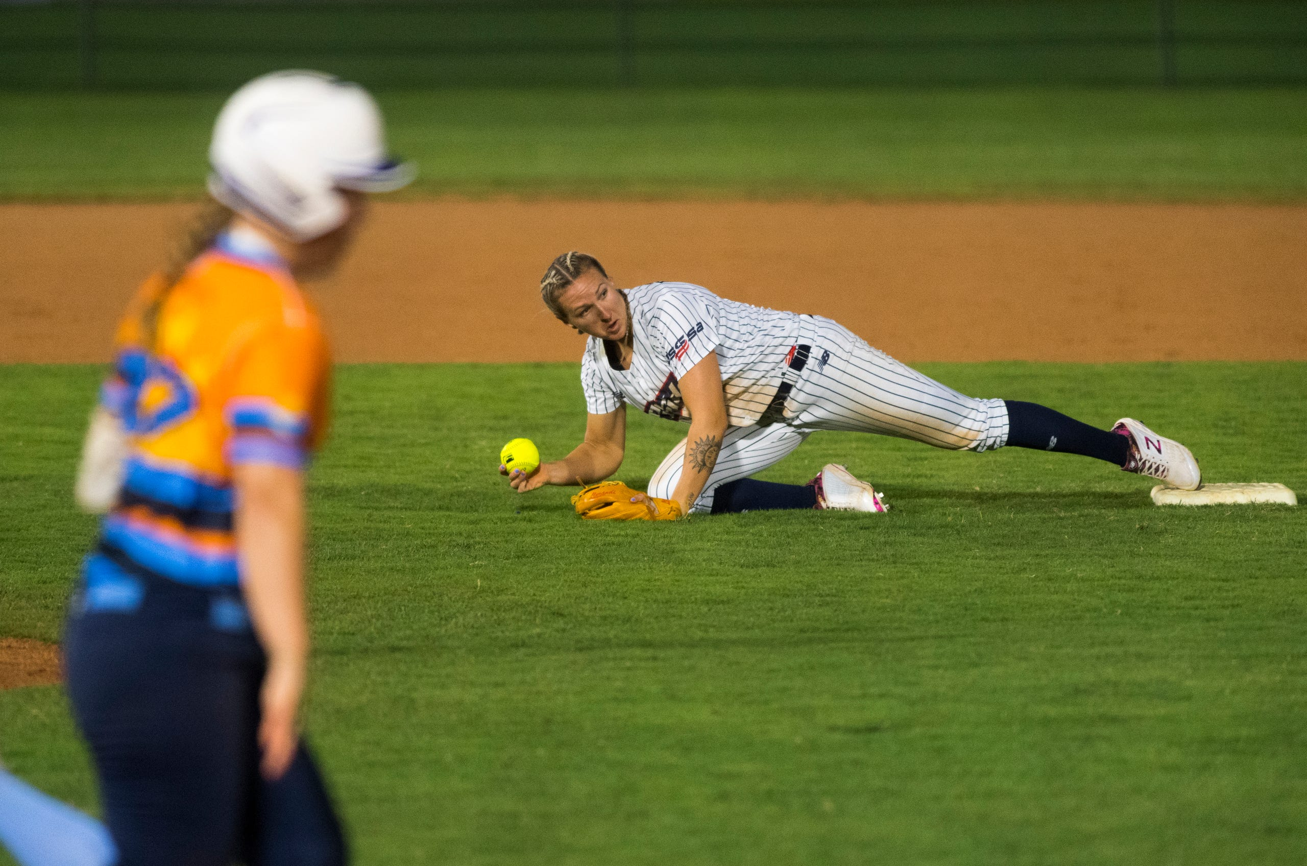 USSSA Pride's Shelby Pendley (2) fields a grounder at second as the USSSA Pride takes on Team Florida in an exhibition game at Bosse Field in Evansville, Ind., Wednesday evening, July 14, 2021.