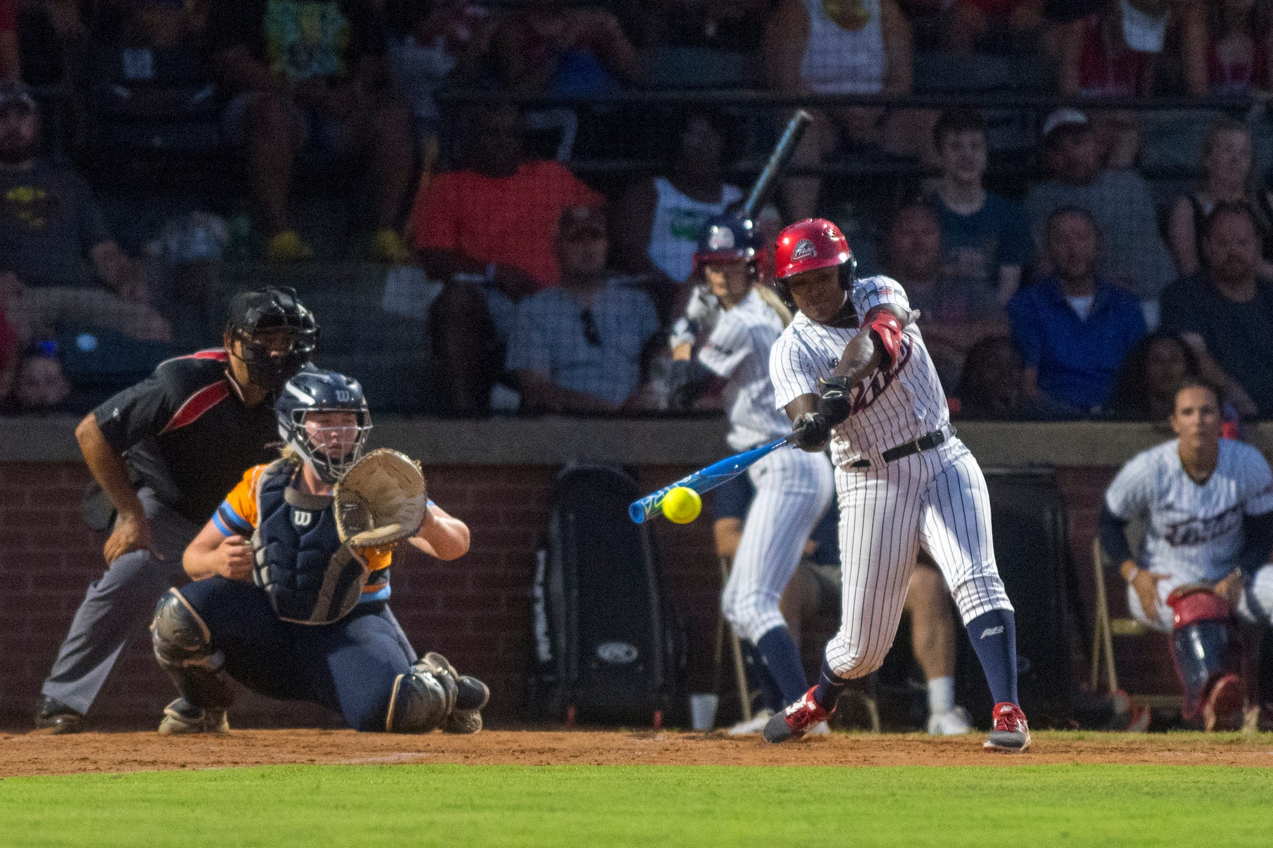 USSSA Pride's Shay Knighten (17) hits the ball as the USSSA Pride takes on Team Florida in an exhibition game at Bosse Field in Evansville, Ind., Wednesday evening, July 14, 2021.