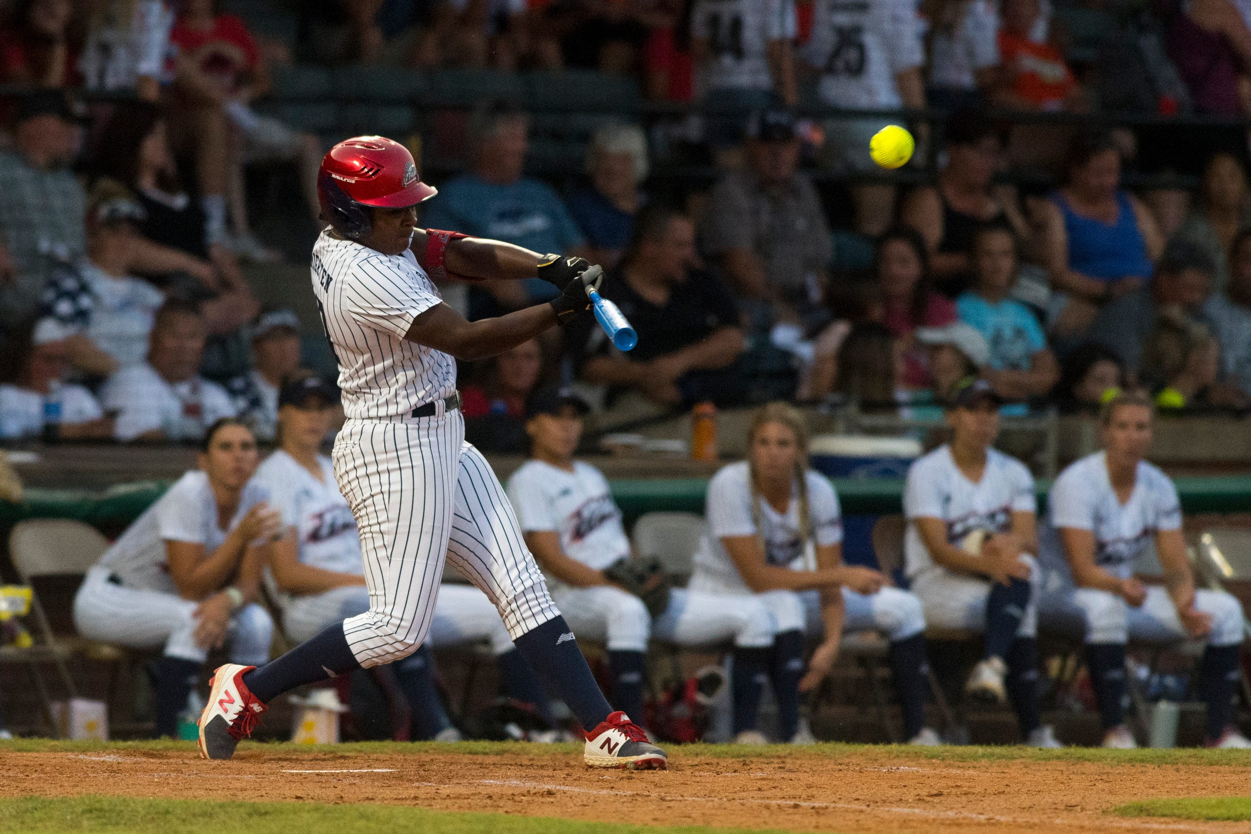 USSSA Pride's Shay Knighten (17) hits a homer as the USSSA Pride takes on Team Florida in an exhibition game at Bosse Field in Evansville, Ind., Wednesday evening, July 14, 2021.