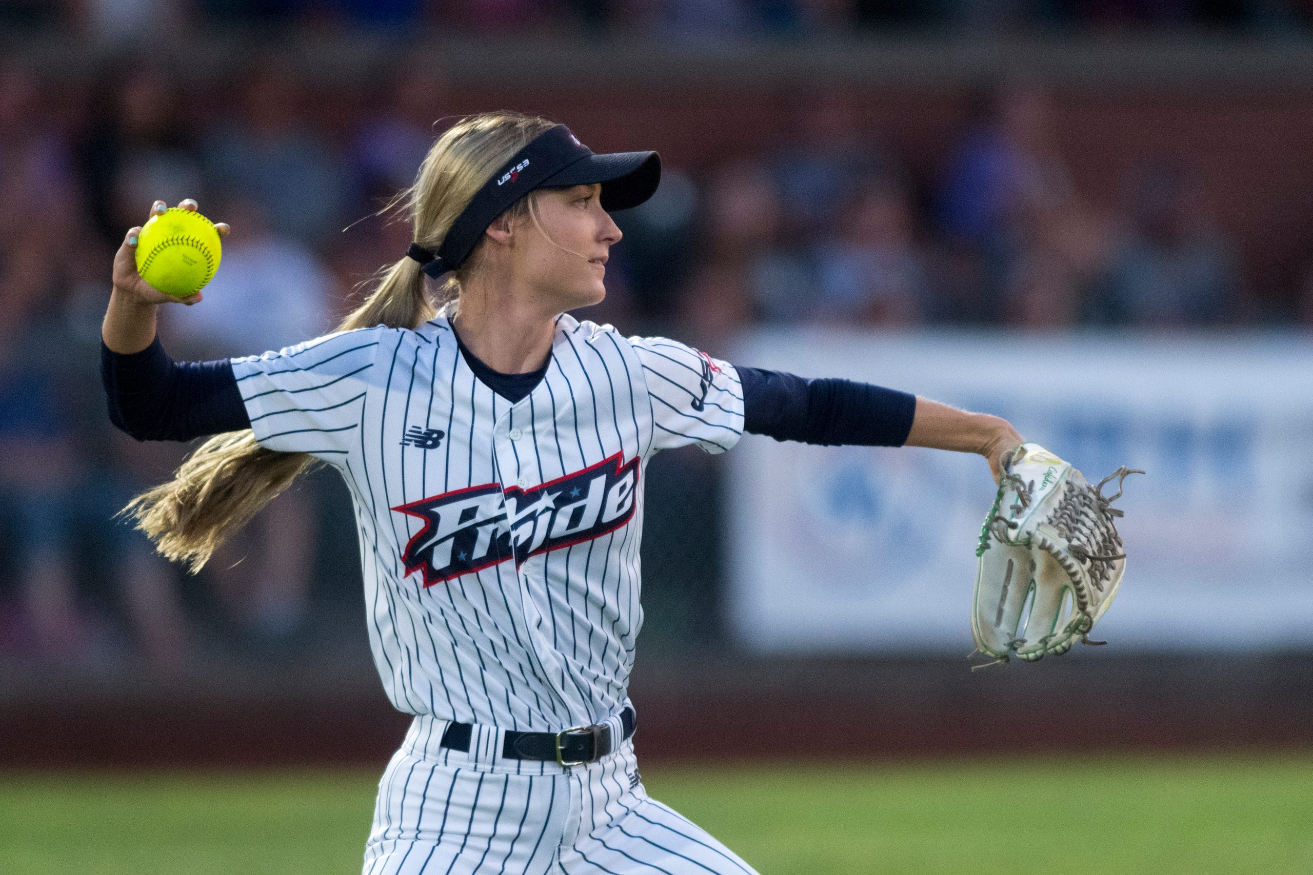 USSSA Pride's Haley Cruse (10) throws from the outfield as the USSSA Pride takes on Team Florida in an exhibition game at Bosse Field in Evansville, Ind., Wednesday evening, July 14, 2021.
