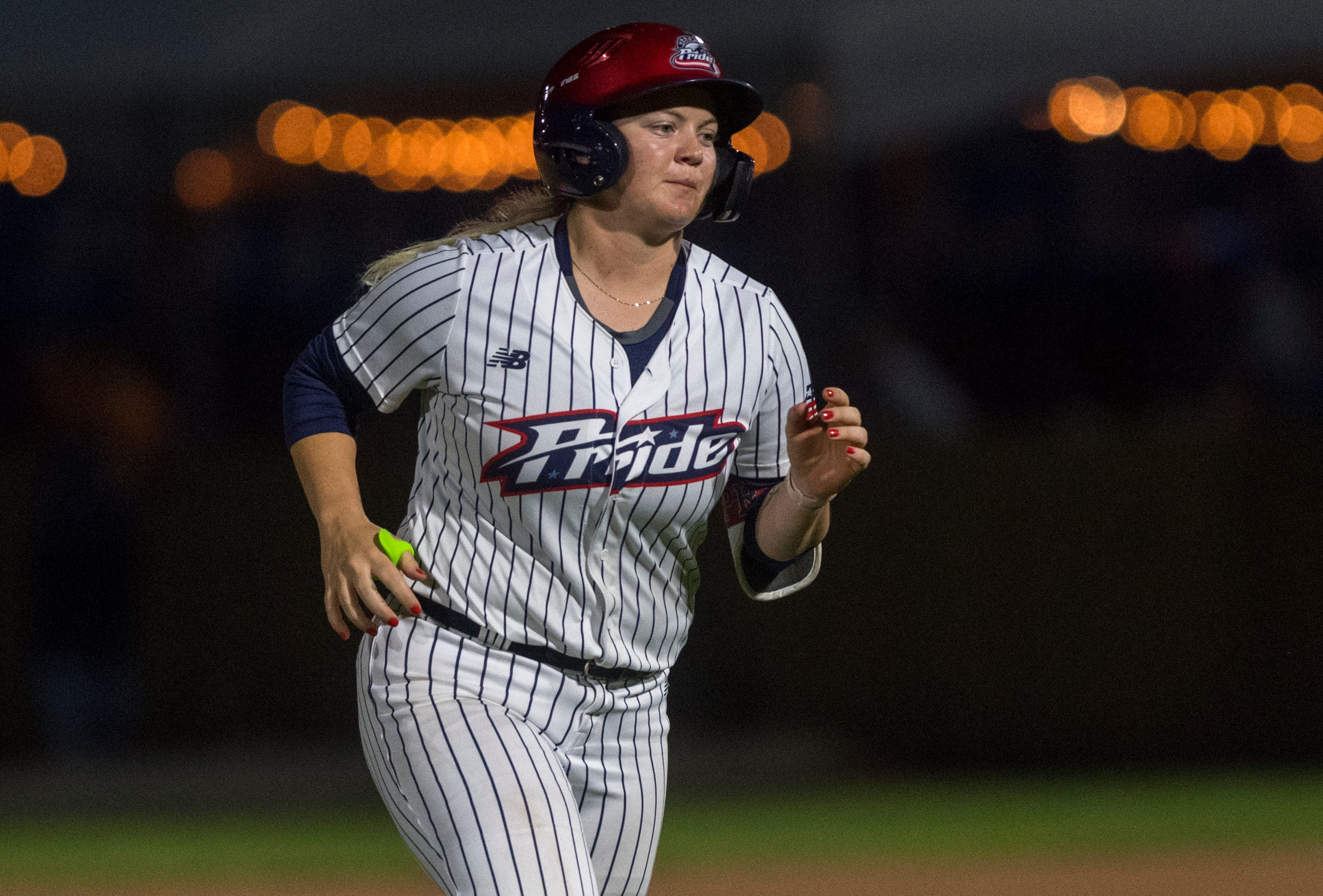 USSSA Pride's Jessie Warren (30) rounds third after hitting a home run as the USSSA Pride takes on Team Florida in an exhibition game at Bosse Field in Evansville, Ind., Wednesday evening, July 14, 2021.
