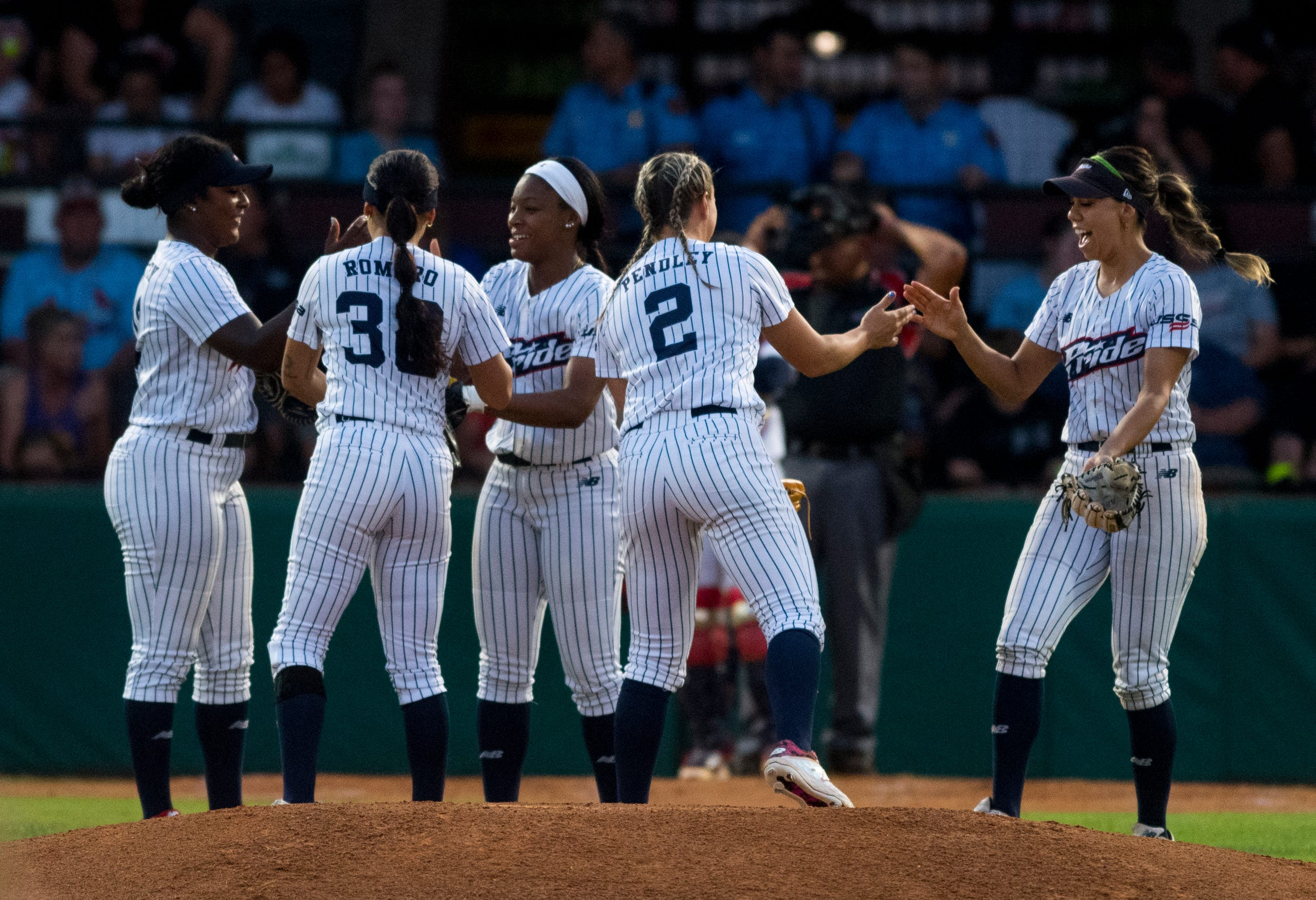 USSSA Pride gather at the mound in the third inning during their exhibition game against Team Florida at Bosse Field in Evansville, Ind., Wednesday evening, July 14, 2021.