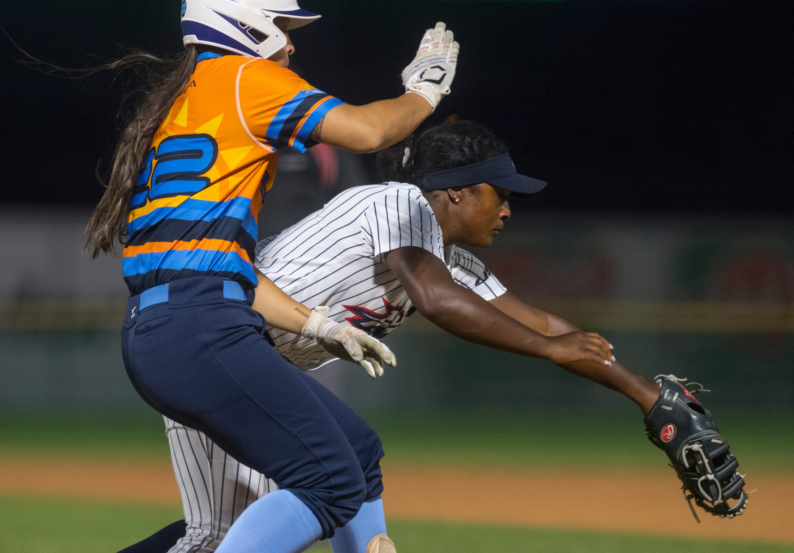 USSSA Pride's Shay Knighten (17) outs Team Florida's Maddi Hackbarth (22) as the USSSA Pride takes on Team Florida in an exhibition game at Bosse Field in Evansville, Ind., Wednesday evening, July 14, 2021.