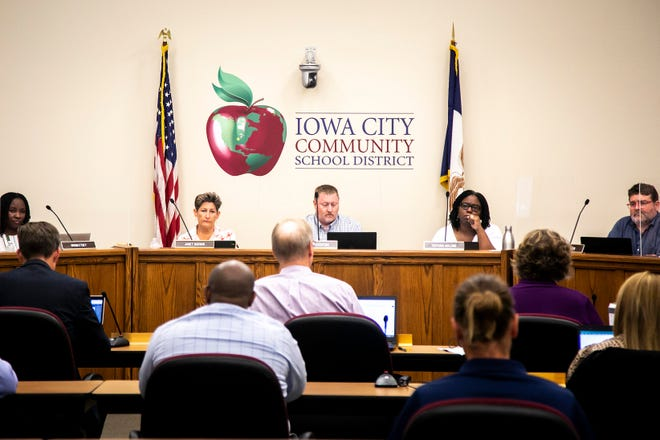 Iowa City Community School District board members, from left, Dromi Etsey, Janet Godwin, Shawn Eyestone, president of the board, Ruthina Malone, vice president of the board, and J.P. Claussen listen to a person present during a meeting, Tuesday, July 13, 2021, at the district's Educational Services Center (ESC) at 1725 North Dodge Street in Iowa City, Iowa. Members not pictured: Lisa Williams and Charlie Eastham.