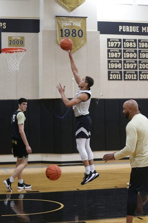 Purdue forward Mason Gillis (0) goes up for a shot during basketball practice, Wednesday, July 14, 2021 in West Lafayette.