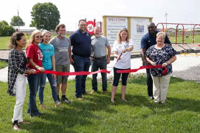 Anna Williams, mother of Abby Williams, cuts a ribbon at the Abby and Libby Memorial Park, Thursday, July 15, 2021 in Delphi. A $50,000 grant from 2021 NBA All-Star grant donated fitness equipment at the park.