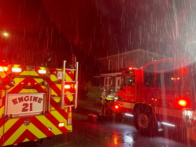 Firefighting crews at the scene of a house fire in the 600 block of 10th Street July 14, 2021, in Kiel.