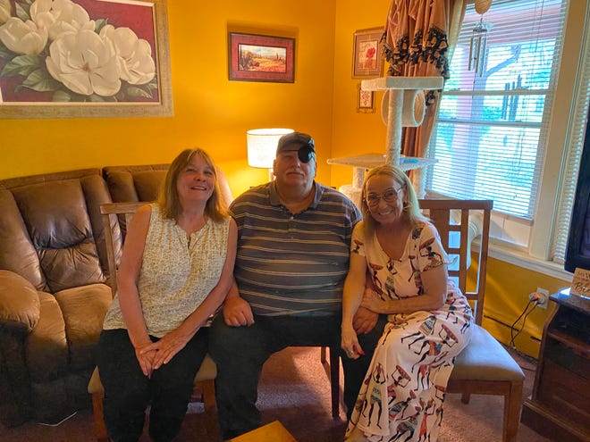 Becky Shaeffer, 69, Curt Livingston, 66, and Vicki Sims, 62, at Sims' house in Marion Tuesday, July 6, 2021. Sims recently met her siblings after finding them through 23andMe.