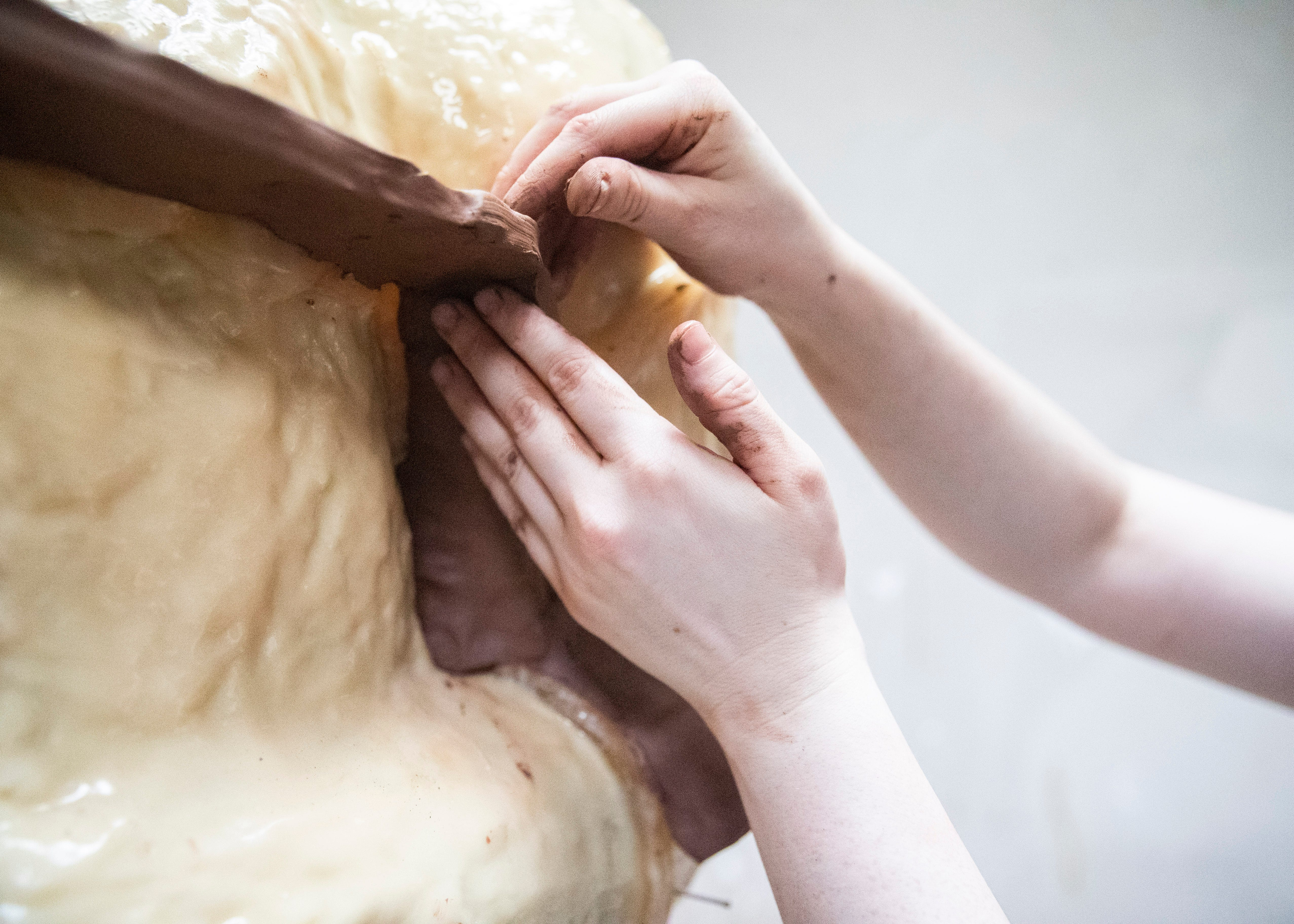 Artisan Emily Hogan makes clay walls to create the statue of  Ida B. Wells-Barnett, the African American civil rights advocate and journalist who fought against racism, segregation and lynching, at the Lugar Bronze Foundry in Eads, Tenn., on Tuesday, May 26, 2021.