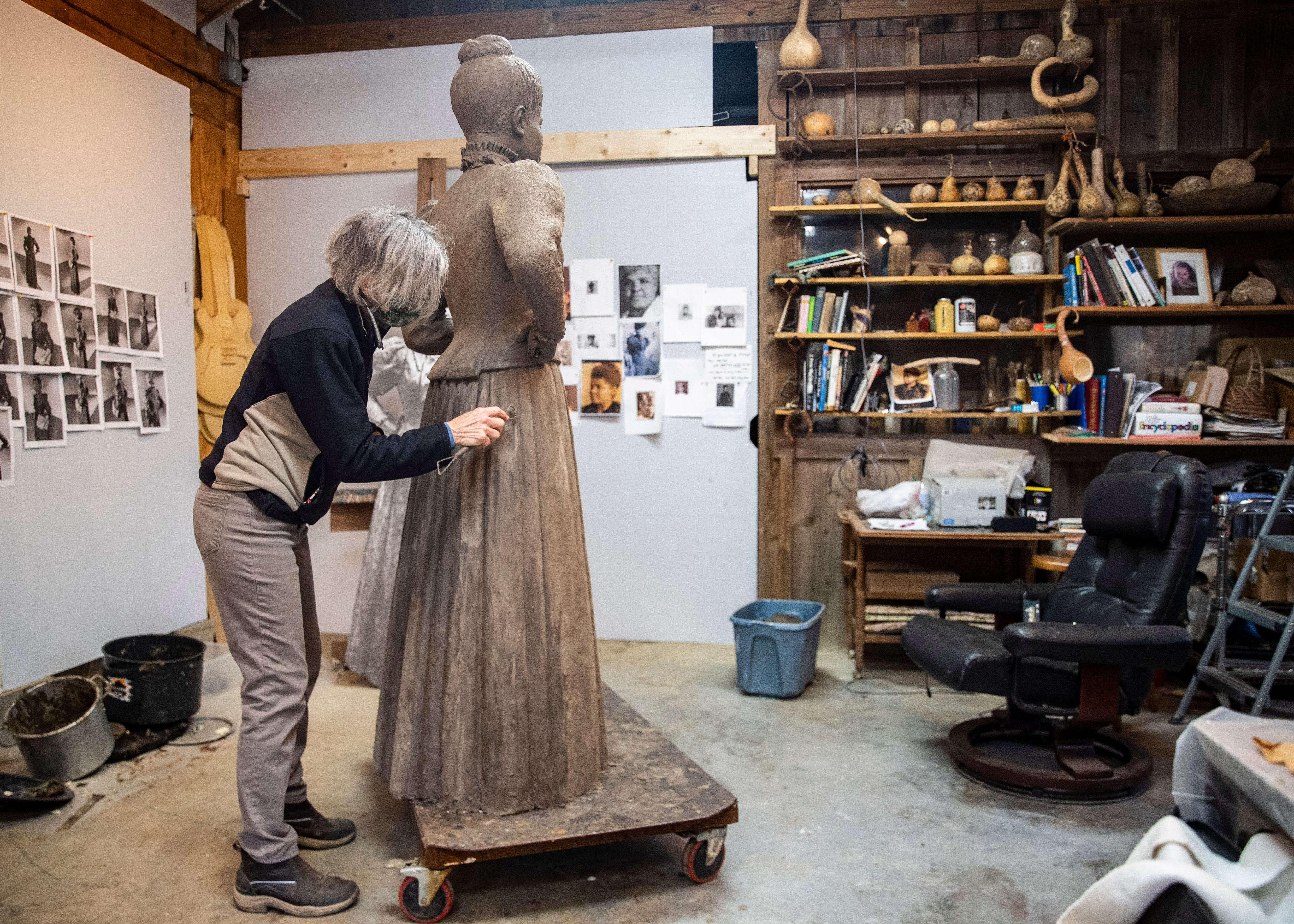 Andrea Lugar of the Lugar Bronze Foundry in Eads, Tenn.,  sculpts the statue of Ida B. Wells-Barnett, the African American civil rights advocate and journalist who fought against racism, segregation and lynching, at her home studio on Friday, March 15, 2021.