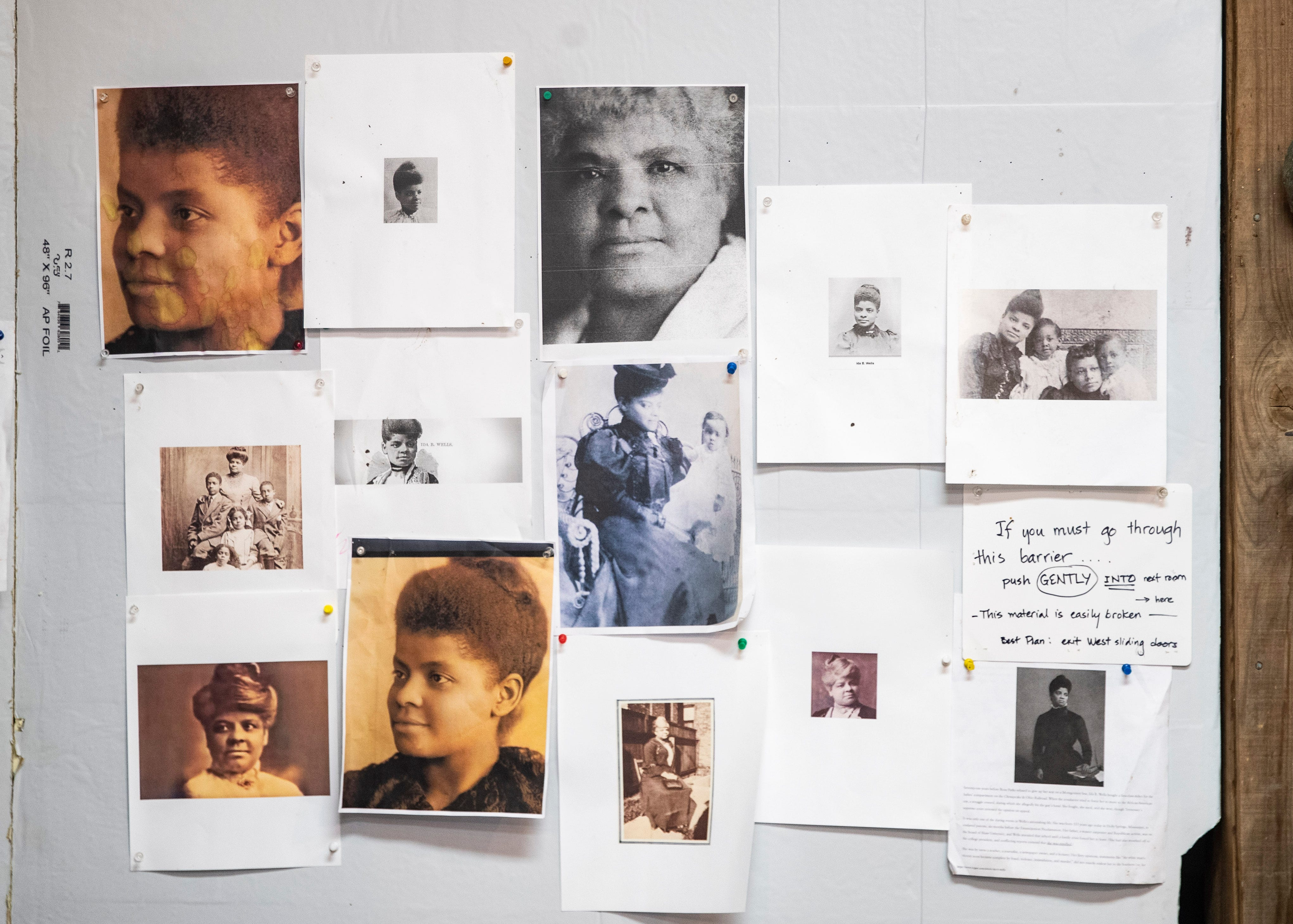 Photos of Ida B. Wells, the African American civil rights advocate and journalist who fought against racism, segregation and lynching, are seen on a wall inside sculptor Andrea Lugar's studio.