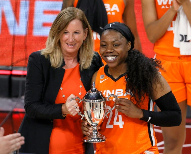 WNBA Commissioner Cathy Engelbert presents the MVP trophy to Arike Ogunbowale of Team WNBA after the 2021 WNBA All-Star Game at Michelob ULTRA Arena on July 14, 2021 in Las Vegas, Nevada. Team WNBA defeated the USA Women's National Team 93-85.