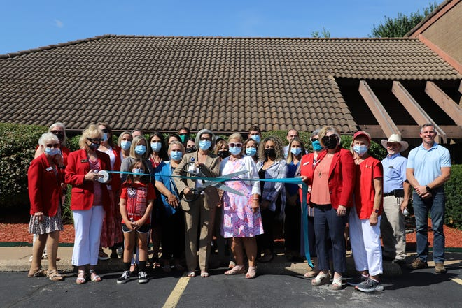 Members of Boston Mountain Rural Health Center cut the ribbon of their new Mountain Home medical clinic.