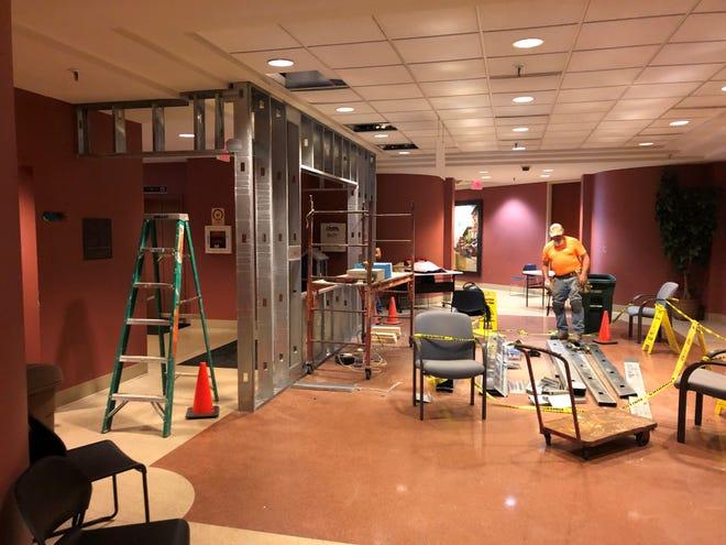 Work began this week on installing new security measures in the first-floor lobby of Muncie City Hall.