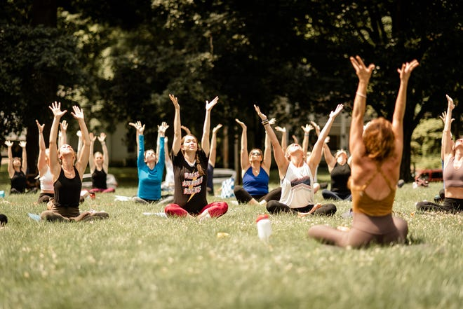 Kalee Maloney, owner ofRadiant Wild, leads the new Granville Saturday morning yoga sessions.
