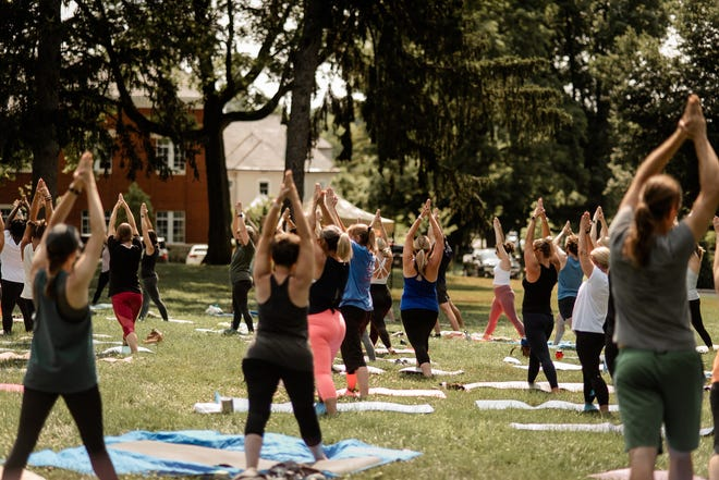 Although the new Saturday morning yoga classes on the Denison green are offered for free, donations benefitting the Licking Land Trust are accepted