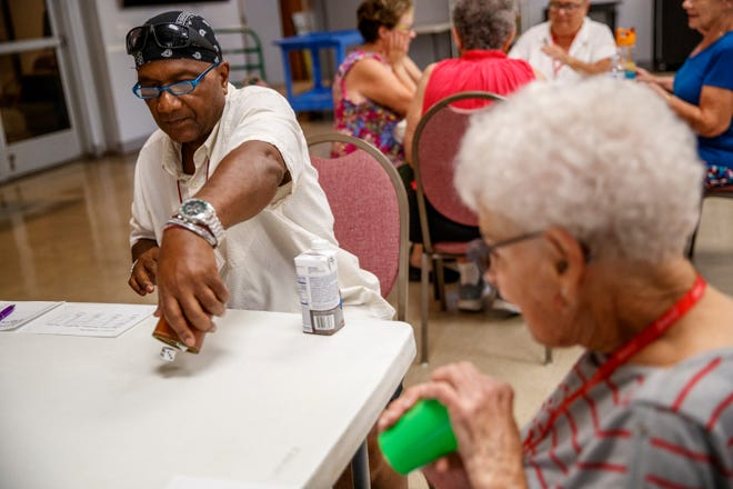 Ulysses Miles plays Bunco at the Cathedral City Senior Center in Cathedral City, Calif., on July 14, 2021.