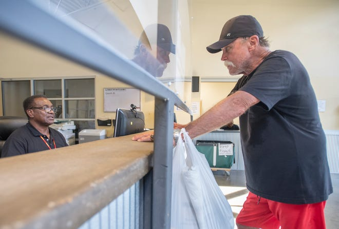 Will Rich checks in July 14 at the Waterfront Rescue Mission on Herman Street in Pensacola. Waterfront's overnight shelter is closed for at least 10 days after a COVID-19 outbreak.