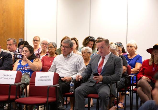 Former Arizona lawmaker Anthony Kern sits next to audience members who watch Senate President Karen Fann and Sen. Warren Petersen during a hearing about the Maricopa County election audit at the Arizona Senate in Phoenix on July 15, 2021.