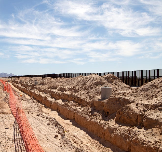The U.S. Army Corps of Engineers and border wall contractors began filling trenches and other remediation work on July 15 at two construction sites at the Barry M. Goldwater Range in Yuma County as part of the Biden administration's efforts to cancel military-funded wall projects.