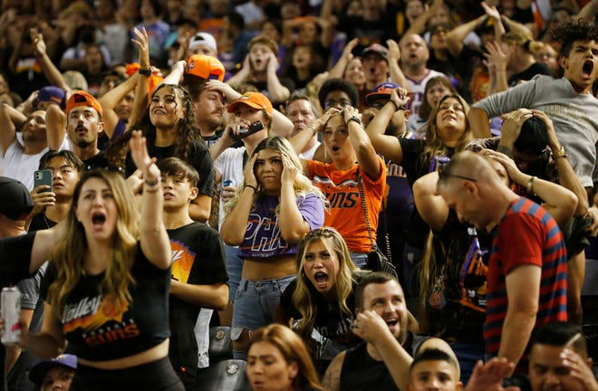 Suns fans react to a Bucks basket inside Chase Field in Phoenix as the Suns lose Game 4 on the road on July 14, 2021.