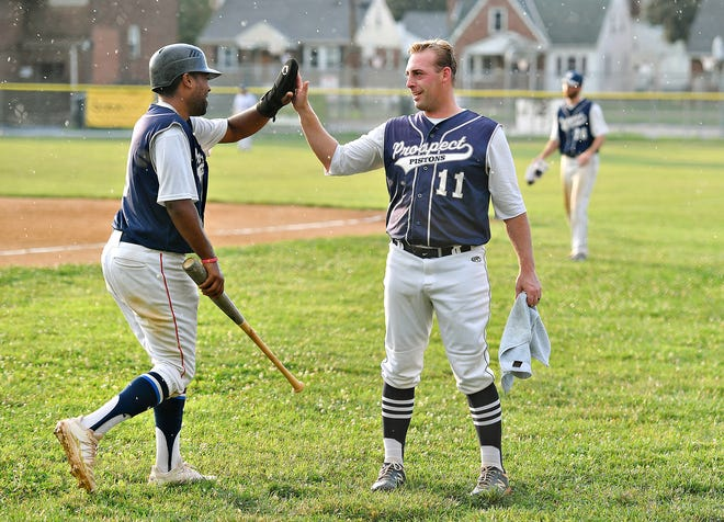East Prospect's Anthony Torreullas, left, and  Ryky Smith celebrate during Susquehanna League baseball action at Hallam Express Field in Hallam, Wednesday, July 14, 2021. East Prospect would win the game 6-3. Dawn J. Sagert photo