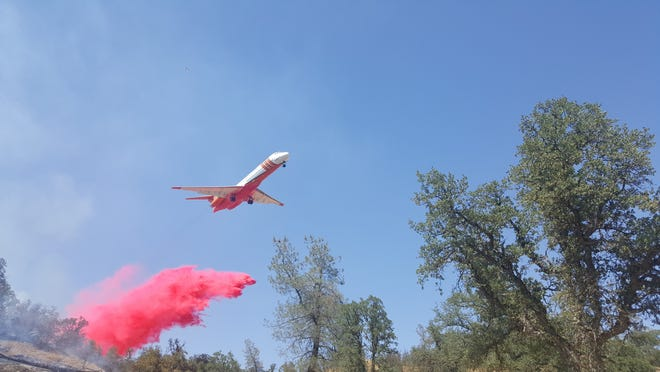 Fire officials drop retardant on the Cannon Fire burning in Tehama County on Wednesday, July 14, 2021.