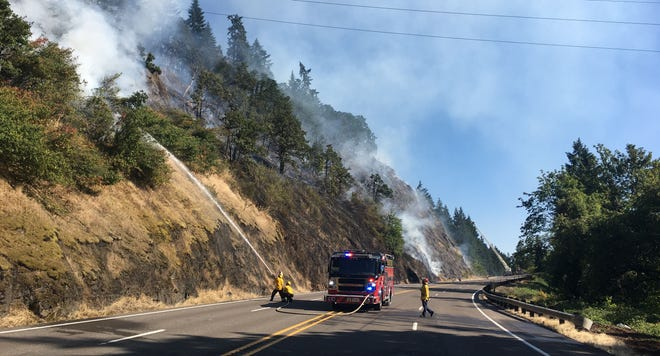 A fire burning in Clackamas County has prompted the closure of Highway 99E Wednesday evening.