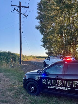 River Road S is closed and more than 100 people are without power after avehicle struck a utility pole near Independence Wednesday evening.