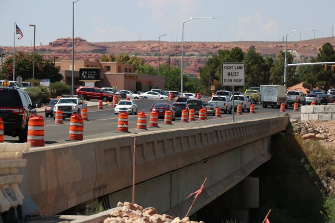 Cars driving through a construction zone on River Road, July 14, 2021.
