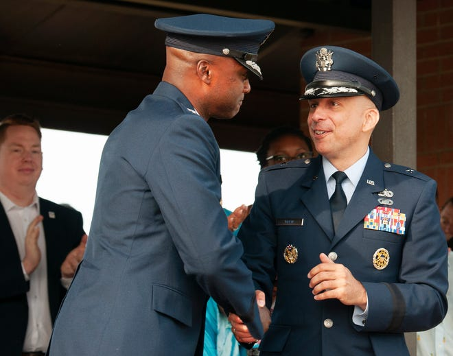 Outgoing 82nd Training Wing commander Brig. Gen. Kenyon Bell, left, congratulated the new commander, Brig. Gen. Drew during a change of command ceremony Thursday morning at Sheppard Air Force Base.