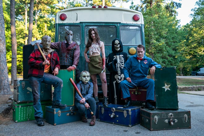 """A """"Family"""" photo for the """"Fear Street"""" villain includes (from left) the Camp Nightwing Killer, The Grifter, Billy Barker, Ruby Lane, Skull Mask and The Milkman."""