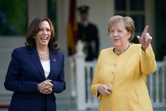 Vice President Kamala Harris greets German Chancellor Angela Merkel as she arrives at the Vice President's residence, the Naval Observatory, Thursday, July 15th, 2021, in Washington.