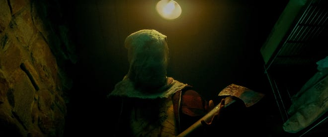 """The Nightwing Killer hunts down summer-camp youth with a bloody ax in """"Fear Street Part 2: 1978""""."""