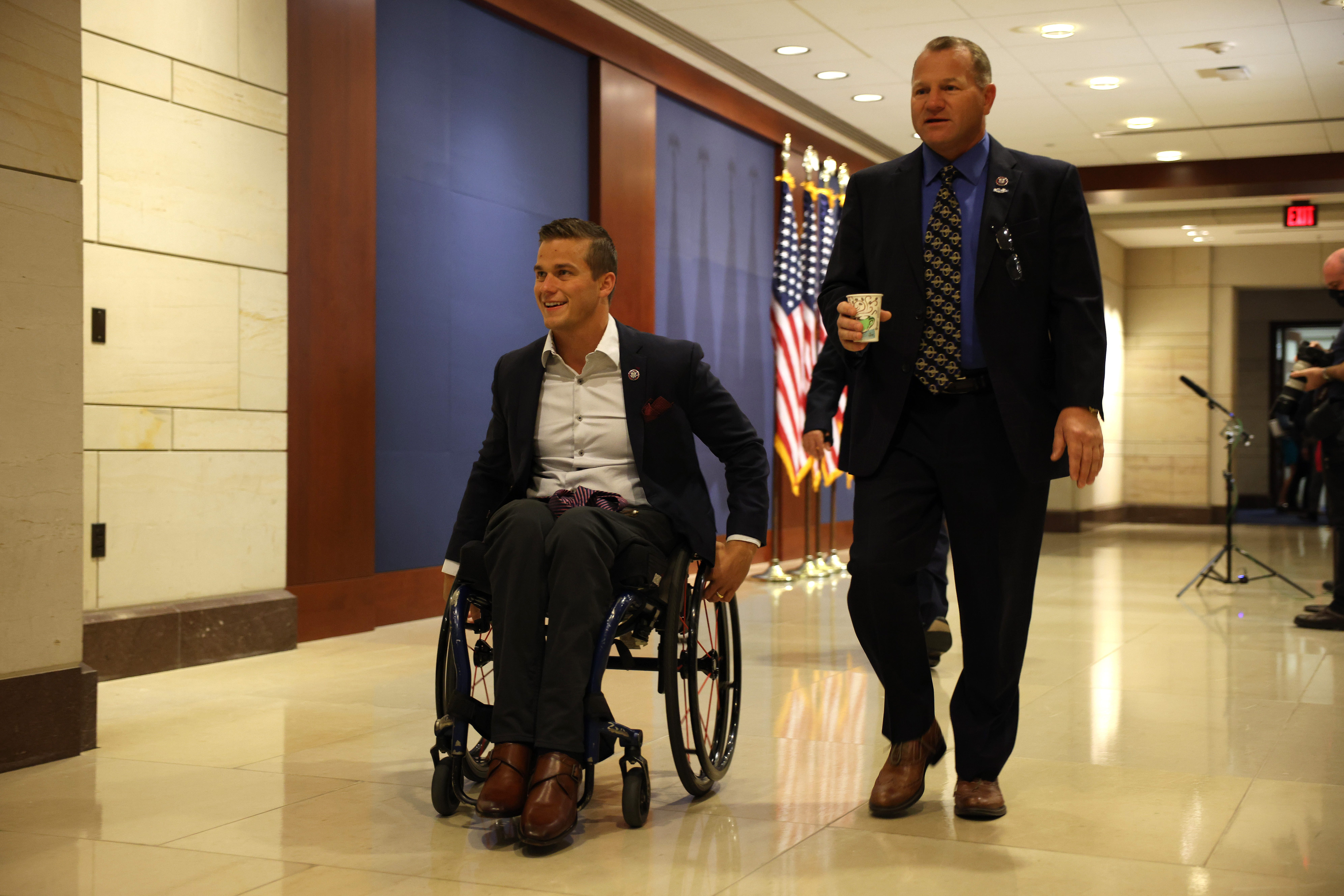 Rep. Madison Cawthorn, R-N.C., left, and Rep. Troy Nehls, R-Texas, arrive May 14, 2021, at a caucus meeting to pick a replacement for Rep. Liz Cheney, R-Wyo., as chair of the House Republican Conference in the U.S. Capitol Visitors Center in Washington, D.C.