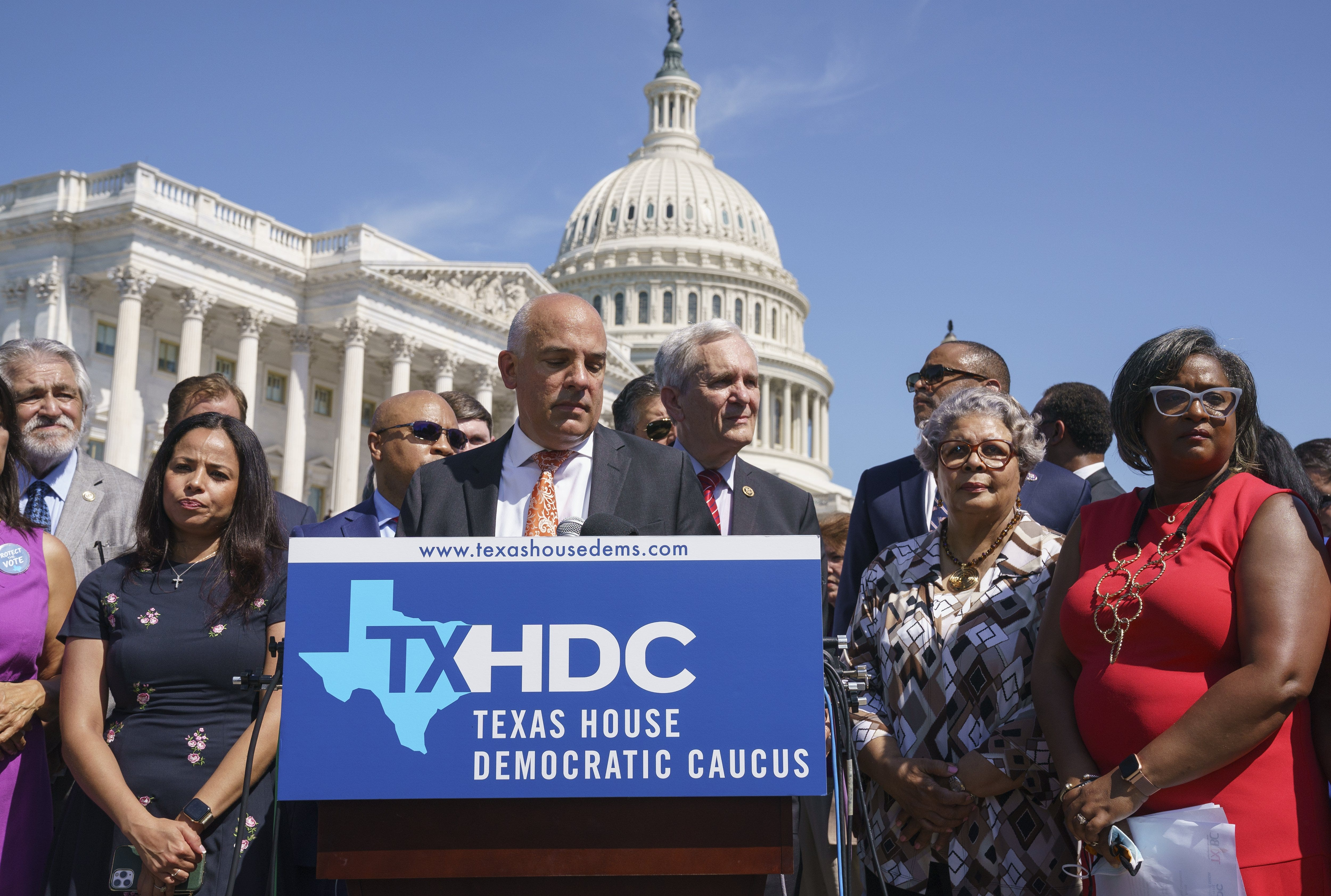 Texas House Democratic Caucus Chairman Chris Turner, center, is joined by fellow Democrats at a news conference at the Capitol in Washington on July 13 after they broke quorum to kill a GOP voting bill.