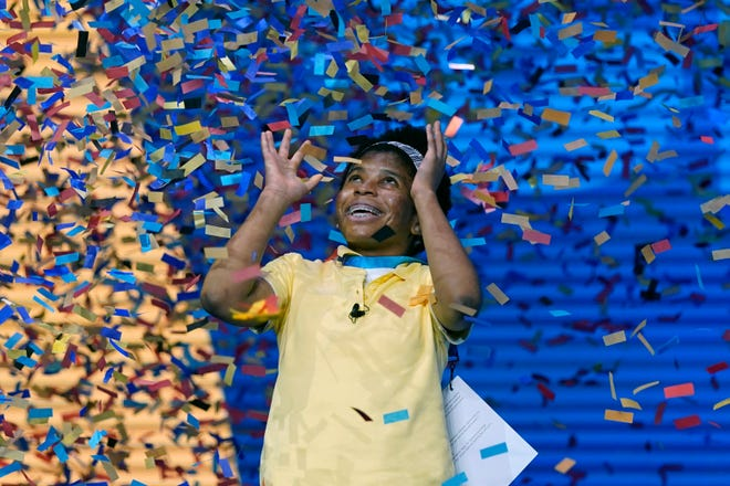 Zaila Avant-garde, 14, is showered with confetti as she celebrates winning the 2021 Scripps National Spelling Bee. [File/Associated Press]
