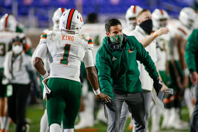Miami coach Manny Diaz congratulates quarterback D'Eriq King after a touchdown pass last December against Duke. Diaz is concentrating his recruiting efforts in the fertile Miami area of South Florida. King, who could be drafted next spring, came by way of transfer.