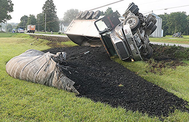 A section of U.S. Route 250 was temporarily closed Thursday morning when a semitractor-trailer carrying a load of coal overturned and spilled its load.