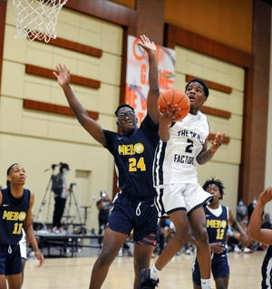 Thomson's Lavonta Ivery, right, goes up for a layup during the 2021 Nike EYBL Peach Jam qualifiers on Friday, July 16, 2021 at the Augusta Convention Center, . [WYNSTON WILCOX/THE AUGUSTA CHRONICLE]