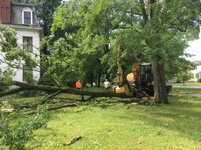 The Dresden DPW clearing fallen trees in the village square the morning after the storm.