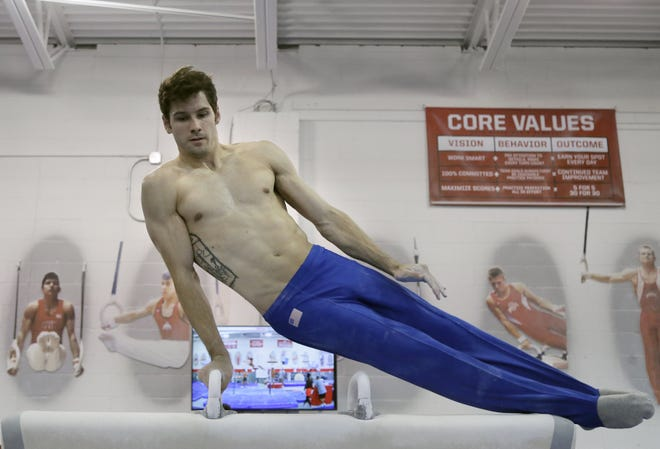 """Ohio State coach Rustam Sharipov believes that Alec Yoder, here practicing in Columbus on Monday, has the physical and mental strength to medal in the pommel horse. """"He's a fighter,"""" Sharipov said."""