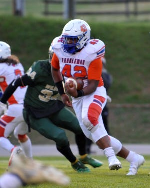 Randleman's Amarion Moton runs against Eastern Randolph. The Tigers have won 37 consecutive conference football games. [Mike Duprez/Courier-Tribune]