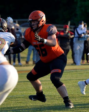 North Davidson's Drew Engelhart blocks against Salisbury in the 2-AA state semifinals last spring. Engelhart and the Black Knights are moving up to the 3-A ranks. [Mike Duprez/The Dispatch]