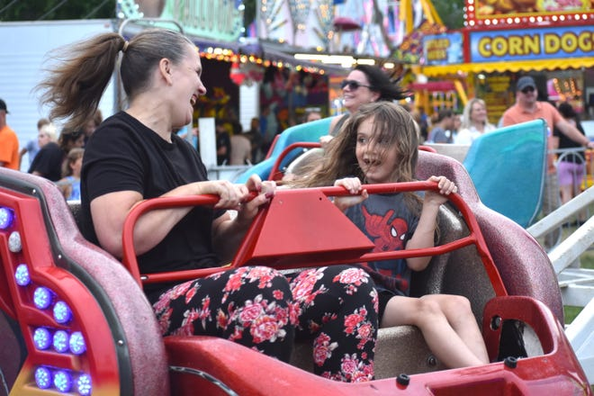 Rosanna Morse, left, and Eli Snyder, 7, both of Hudson, have some fun July 10 riding on the Sizzler amusement ride during the River Raisin Festival in Blissfield.