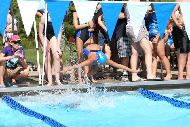 Gwendolyn Frolich, center, dives into the water at Adrian's Bohn Pool during a July 2017 swimming meet for the Bohn Pool Waverunners. Because of mechanical and structural issues this summer at Bohn Pool, the community swimming facility has been inactive. It will finally open for the season at 1 p.m. Sunday, July 18, now that repairs have been made.