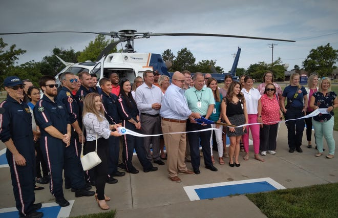 B. J. Tyner, Area Manager for LifeSave Transport with Air Methods, a company headquartered in Colorado, and Rick Wallace CEO of HPMC, cut a ribbon welcoming new emergency air services to Dodge City and celebrate better medical options in western Kansas.